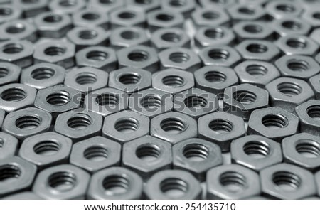 Metal nuts as background - stock photo
