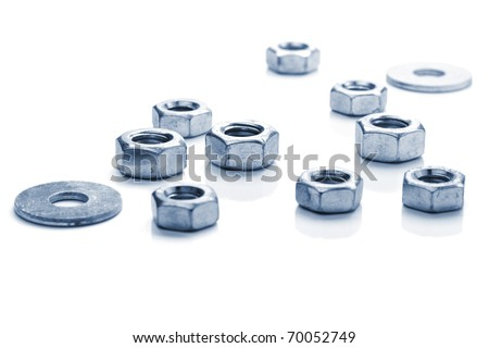 Metal nuts. Isolated on white background. Toned