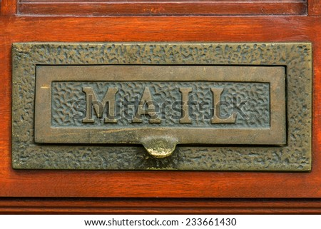 metal old mail box on the door - stock photo