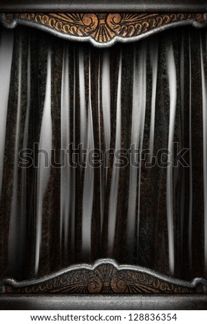 Metal on black silk curtain