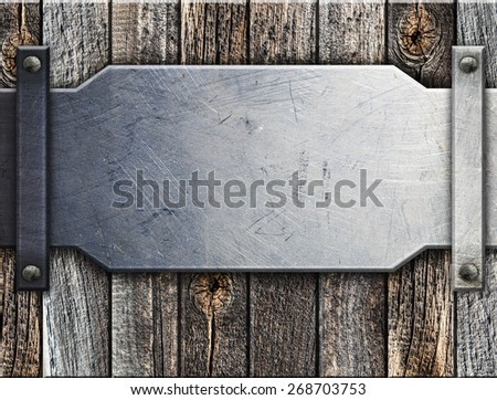 Metal  on old wooden background for design