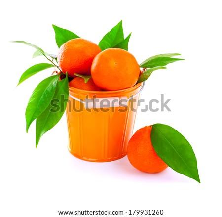 Metal orange bucket of fresh ripe mandarins isolated on white background, natural dessert, tropical fruit, diet concept  - stock photo