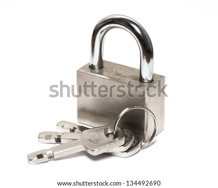Metal  padlock with keys on a ring isolated on white background. - stock photo