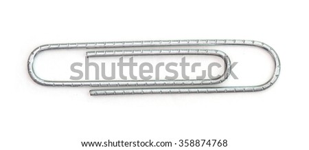Metal paperclip isolated on white background. - stock photo