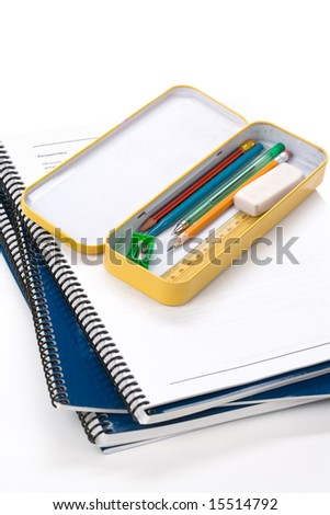 Metal pencil case and book with white background