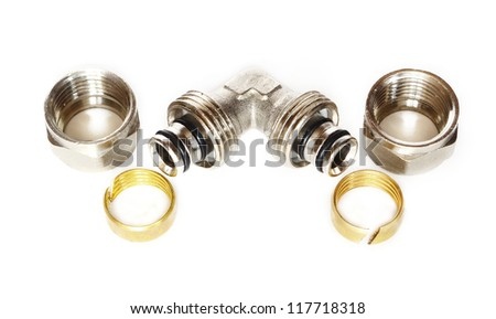 metal pipe tee, nut and locking ring - stock photo