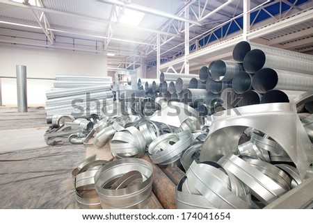 Metal Pipes in Modern high-tech factory workshop construction site - stock photo