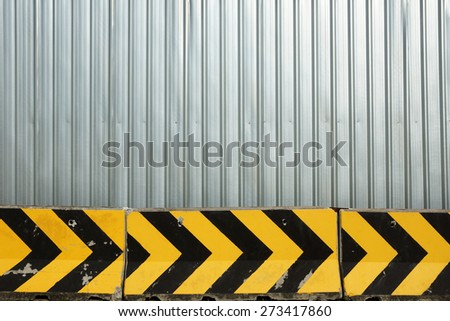 Metal plate fence and concrete barrier for background - Construction zone - stock photo