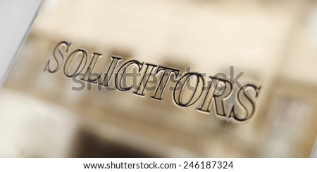 Metal plate of a solicitor's office. - stock photo