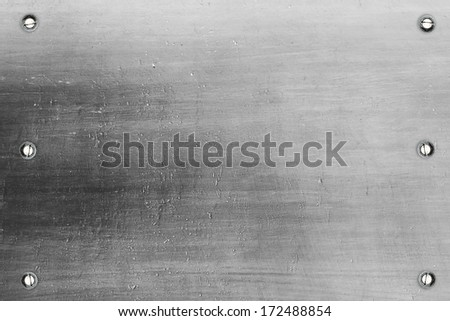 Metal plate surface with screws - stock photo