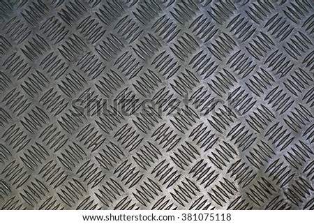 Metal plate with a corrugated surface - stock photo