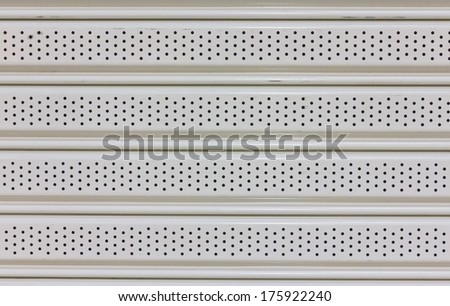 metal plate with holes - stock photo