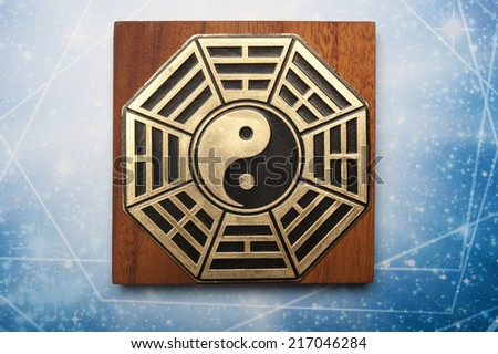 metal plate with I-ching and yin yang symbols  - stock photo