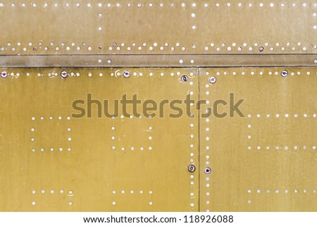 Metal plate with rivets - stock photo