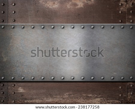 metal plate with rivets over rustic steel background - stock photo