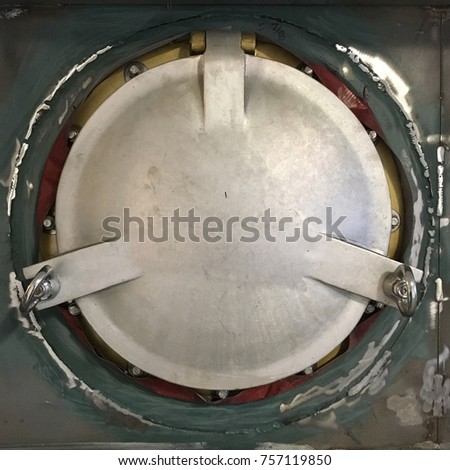 Metal porthole hatch door surrounded by distressed steel & Metal Porthole Hatch Door Surrounded By Stock Photo (Download Now ...