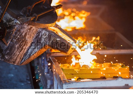 metal pouring in casting line production - stock photo