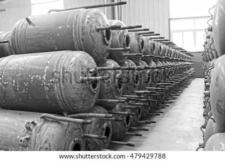 Metal pressure tank piled up together, closeup of photo