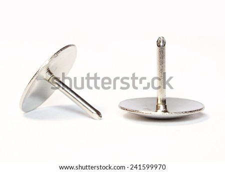 Metal Pushpin or Drawing Pin isolated on white background - stock photo