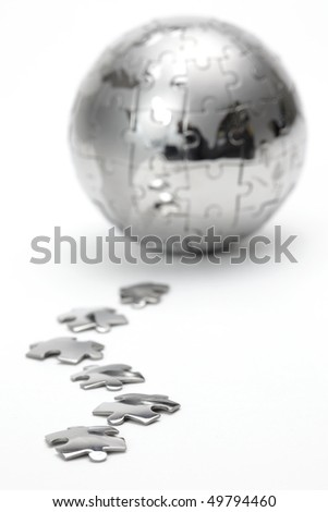 Metal puzzle globe isolated on white background - stock photo