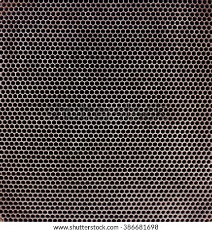 Metal radiator grill as background