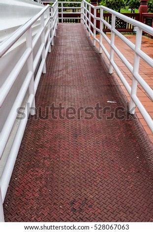 Metal ramp for wheelchair