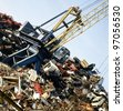 Metal recycling site over blue sky - stock photo