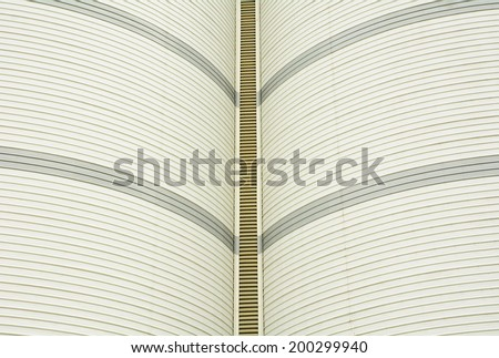 Metal roof curve industrial background - stock photo