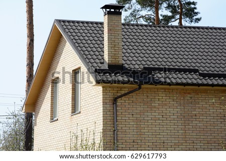 Metal roofing. Closeup on new rain gutter system and roof protection from snow board ( & Chimney Roof Snow Stock Images Royalty-Free Images u0026 Vectors ... memphite.com