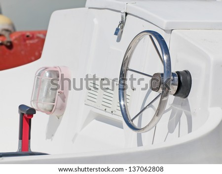 metal rudder on a white boat - stock photo