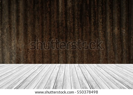 Metal rust wall texture background surface natural color , process in vintage style with wood terrace