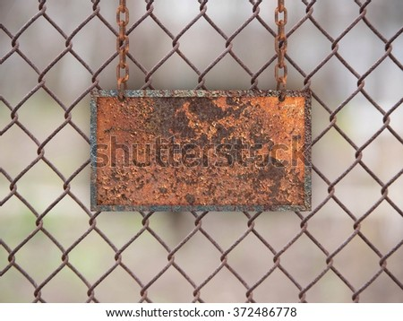 Metal rusty sign on the chains