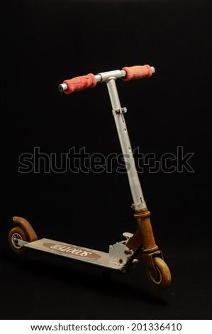 Metal scooter for child on white background