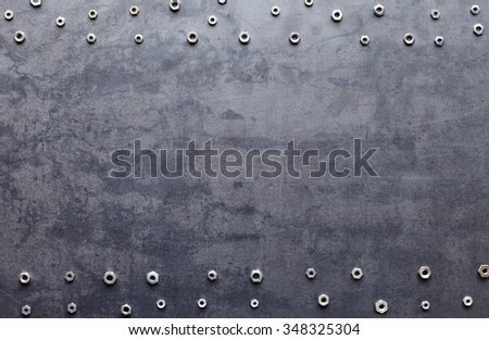 metal screw nuts frame on metal texture background - stock photo