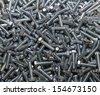metal screws closeup as background - stock photo