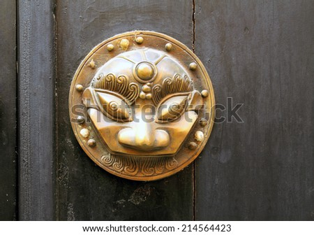Metal sculpture on the door Mask