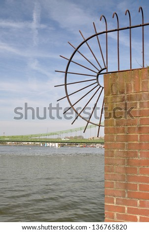 Metal security barrier by River Thames, Hammersmith, London, England, UK - stock photo