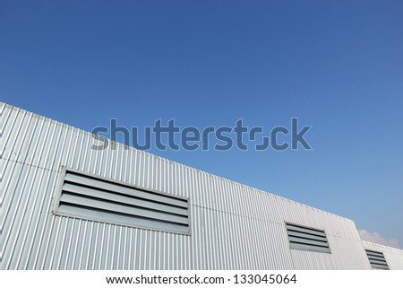 metal sheet roof with blue sky - stock photo