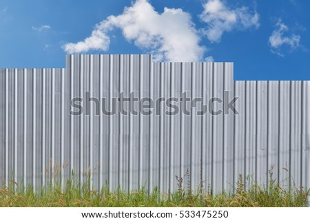 Metal Sheet Wall with blue sky