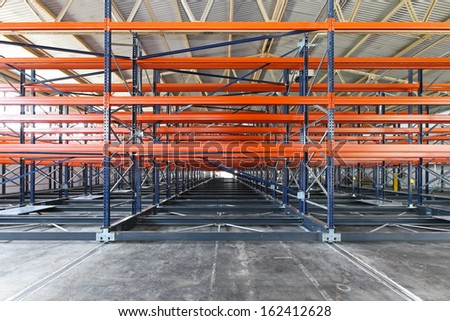 Metal shelves for pallets in distribution warehouse
