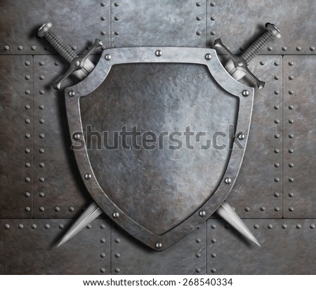 metal shield and two crossed swords over armor plates metal background - stock photo