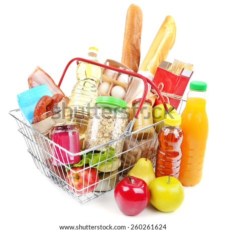 Metal shopping basket with groceries isolated on white - stock photo