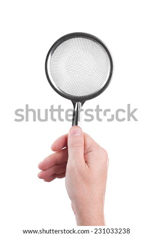 metal sieve in a human hand isolated on white background - stock photo