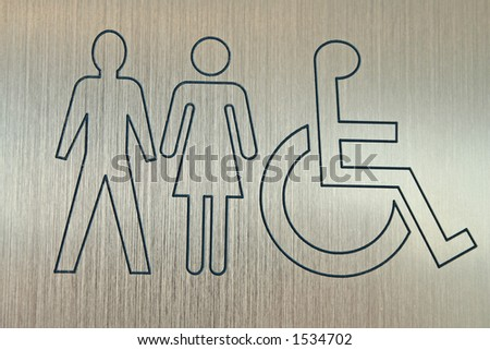 metal sign showing accessible washrooms for men and women - stock photo