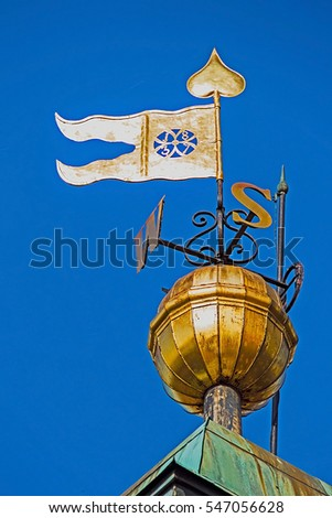 Metal signs with cardinal points and flag, placed on the clock tower in Novi Sad, to be visible for sailors.
