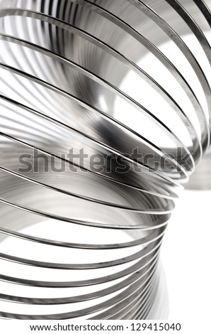 Metal slinky toy close-up - stock photo