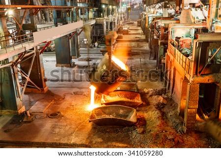 Metal smelting furnace in steel mills - stock photo