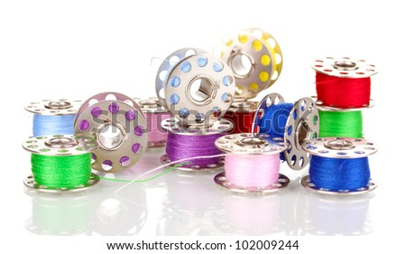 Metal spools of thread isolated on white - stock photo