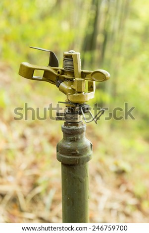 Metal sprinkler with blur background - stock photo