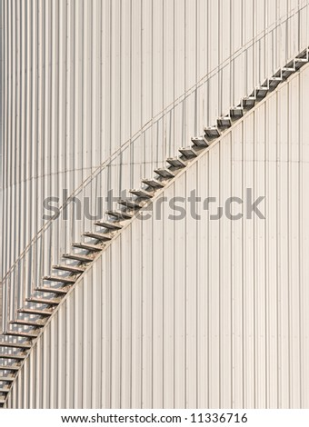 Metal staircase swirling around a storage tank.
